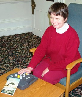 Visually Impaired Person reading Every Day with Jesus using DAISY CD Player. Click here to go to Torch literature resources