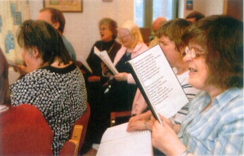Sight impaired person enjoys worship using a Giant Print hymn book
